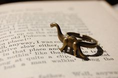 Hey, I found this really awesome Etsy listing at https://www.etsy.com/listing/210278812/gold-dinosaur-brontosaurus-ring-kids