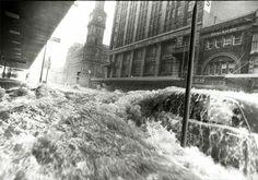 A wall of water running down Elizabeth Street, 1972. Photo: Neville Bowler