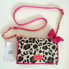 🎉HP🎉 Betsey Johnson crossbody! Beautiful Betsey Johnson crossbody mini bag!  Animal print in beige and brown tones against dramatic pink trim and gold hardware!  Packed with personality! Betsey Johnson Bags Crossbody Bags
