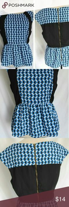 """NWOT Juniors baby doll blouse Ruffled bottom / geometric print / upper back zipper / black trim on side front and along back / soft fabric / 100% polyester    Measurements: 23"""" LENGTH  46"""" BOTTOM WIDTH  30"""" sewn from straight part and ruffles  36"""" CHEST, 40"""" stretched one clothing Tops Blouses"""
