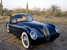 1953 Jaguar XK120 fixed head coupe.