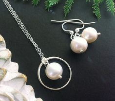 Set of 4,Bridesmaid gifts,Eternity and pearl necklace,Circle necklace,Wire wrapped pearl earrings,Wedding jewelry set. $160.00, via Etsy.