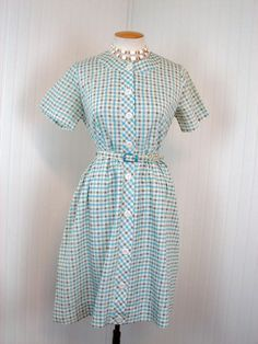 1950s Dress -  HOP SKIP JUMP Vintage 50s Blue White Plaid Day House Dress w Lucite Buttons l xl. $58.00, via Etsy.