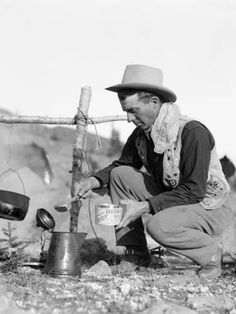size: Photographic Print: Cowboy Kneeling By Campfire, Pouring Coffee Grounds Into Pitcher by H. Cowboy Food, Cowboy And Cowgirl, Urban Cowboy, Cowgirl Style, Real Cowboys, Cowboys And Indians, Serge Gainsbourg, Gaucho, Cowgirls