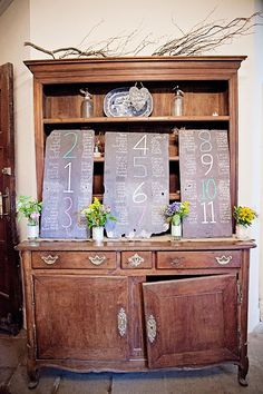 chalkboard table plan on vintage dresser | Ciaran and Louise's perfectly pastel Borris House wedding by Katie Kav | www.onefabday.com
