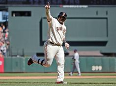 San Francisco Giants' Pablo Sandoval celebrates as he rounds the bases following his two-run home run against the Milwaukee Brewers during the fifth inning of a baseball game on Sunday, Aug. 31, 2014, in San Francisco. (AP Photo/Marcio Jose Sanchez)