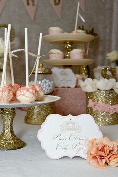 Cake table at a gold and pink Cinderella inspired children's party