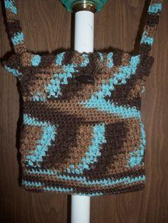 Crocheted Blue Camaflouge Purse - http://www.craftshowcase.net/catalog/handmade-bags-purses/crocheted-blue-camaflouge-purse/?osCsid=4t941c6ei7avqdp8m0kqc1n3t4