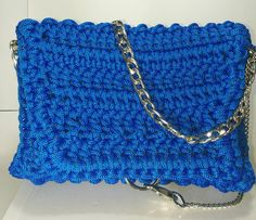 A personal favourite from my Etsy shop https://www.etsy.com/listing/500211347/womens-blue-handbag-with-silver-chain