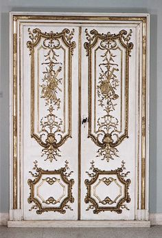 Four doors with trims and one set of entre-portes   Maker: Jean François Cuvilliés the Elder (German (born Belgian), Soignies 1695–1768 Munich)   Artist: Paintings in the manner of Ambrosius Hörmannstorfer (German, died 1781)   Date: ca. 1730–35  Culture: Southern German, Munich  Medium: Wood, painted, carved and gilded  Dimensions: 95 x 29 in. (241.3 x 73.7 cm)