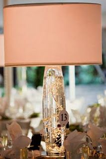 Lamp centerpiece. white flowers within with an ivory lampshade