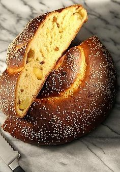 Light in texture, this rich challah is studded with fresh apples and raisins.