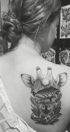 South Africa scene embedded into the head of a giraffe tattoo