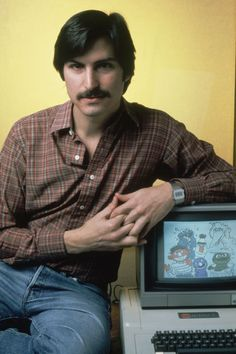 Steve Jobs with the Apple II home computer