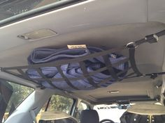 Loaded up Raingler ceiling net in 3rd gen 4Runner, mounted with 200# anchor points, adjustable down for bags, jackets etc.  flush and out of view for everyday use.  #RAINGLERNETS #TOYOTASTORAGE #4RUNNERCAMPING