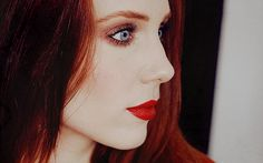"""Simone Simons (EPICA): Justly known for her beauty (genetic lottery win) and elegance (good taste) and voice (good training). Must admire her attention to detail as she is not a natural redhead yet she completes the illusion by also coloring her eyebrows. """"Blondes"""" with black brows take note, roots aren't the only give-away."""