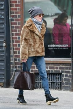 Julianne Moore in a fur coat, jeans and black booties.