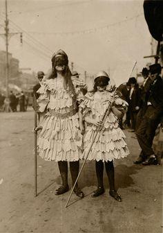 Children wearing Mardi Gras costumes in New Orleans,...