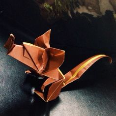 Rat.  Designed by Eric Joisel. Folded by me. For those of you that don't know, Eric Joisel was an incredible origami artist who sadly passed away a few years ago. His designs were so lifelike and incredible.