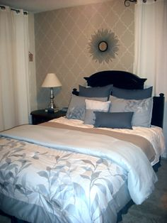 Painted Headboard black small bedroom gray blue white added taupe wallpaper
