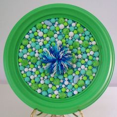 Mosaic picture art. Kitsch plastic brooch.  Kelly green and turquoise.  Plastic beads.  Round frame.  Repurposed.
