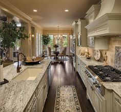 French Country Home Kitchen design. Dark wood floors, light cabinets and marble counter tops. #lightwoodcountertops