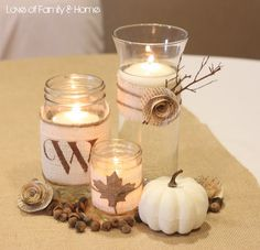 Maybe not exactly these items, but a grouping with a small pumpkin, some acorns and vases/jars with flowers