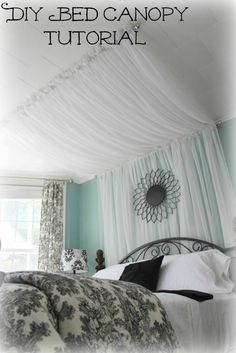 Super cute idea - DIY Bed Canopy. Going to do this in my 9 & 11 yr old daughters bedroom with soft yellow sheers and a really cute Pink metal butterfly they already have in place of the black one in the picture :) Follow the link for a complete tutorial:   http://iamthatlady.com