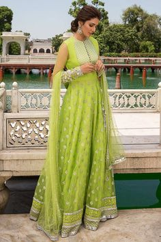 Cast a spell with this Light Green Net Anarkali Suit Which will surely tell them that the diamonds aren't the only beautiful thing which they have seen. This Closed neck and Full Sleeves Party Wear Attire highlighted with resham, zari and stone work. Costumes Anarkali, Anarkali Suits, Anarkali Dress, Lehenga, Salwar Kameez, Gharara Pants, Olive Green Weddings, Angrakha Style, Frock For Women