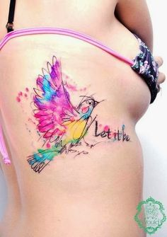 Love the use of colour; pretty bird watercolor tattoo