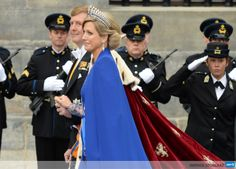 NETHERLANDS, Amsterdam: King Willem-Alexander of the Netherlands leaves with his wife Queen Maxima after his inauguration ceremony on April 30, 2013 at Nieuwe Kerk (New Church) in Amsterdam. AFP PHOTO / PATRIK STOLLARZ