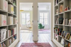 On the second floor, Jack and Jill kids' rooms are fronted by a library/play space. The Canvas Storage Boxes on the shelves are from Kaikai & Ash. Elizabeth Roberts, Built In Sofa, Lane Furniture, Interior Windows, Second Floor, Townhouse, Architecture Design, Home And Family, House Design