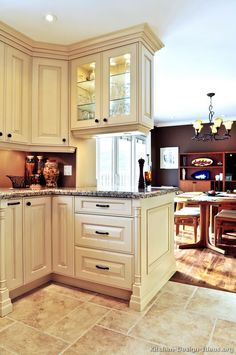 Traditional Antique White Kitchen Welcome! This photo gallery has pictures of kitchens featuring cream or antique white kitchen cabinets in traditional styles.