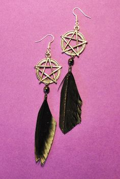 The Modern Witch feather-goddess earrings. $13.00, via Etsy.