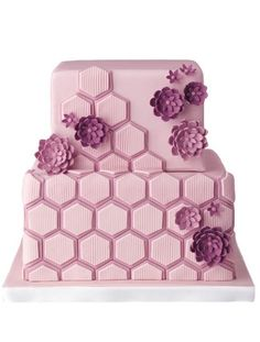 Funky Purple Wedding Cake - Small sugar flowers soften an otherwise modern, geometric cake. Cake by Coco Paloma Desserts