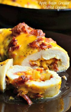 Scrumdelicious stuffed chicken dinner and it's super easy to make. Juicy chicken breasts stuffed with sweet apples, crispy bacon and sharp cheddar cheese.