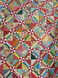 Scrappy quilt by treasureup, via Flickr  -Yet another way to use up these scraps!