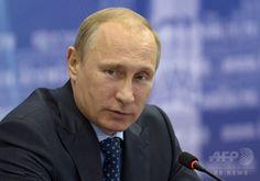 ロシア南部サマラ(Samara)での会議に出席したウラジーミル・プーチン(Vladimir Putin)露大統領(2014年7月21日撮影、資料写真FILE)。(c)AFP/RIA-NOVOSTI/ALEXEI NIKOLSKY ▼23Jul2014AFP|ロシアでのSNS存続が不可に?プーチン大統領が新法に署名 http://www.afpbb.com/articles/-/3021257 #Vladimir_Putin