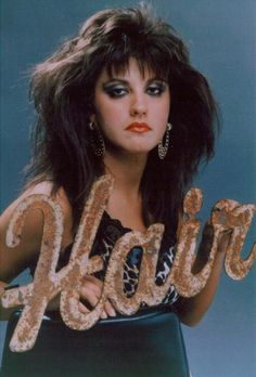 80's hair (airspray was the name of the game. The were horrible for your hair.  I remember using: Rave, Aquanet, White Rain, & Vidal)...lol