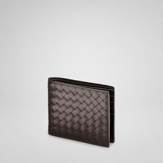 """Simple functionality and flawless leather make the Bottega Veneta flap wallet an investment in style. VN is a particularly smooth leather. With eight credit card slots, two bill compartments and two inside card compartments.    Lining:Leather    Dimensions:4.3"""" W x 3.7"""" H x 0.6"""" D    11cm W x 9.5cm H x 1.5cm D"""