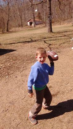 Matthew tossing the football.