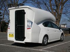 Toyota Prius ... green camper ! http://www.motorhome-travels.co.uk/ (I think this is too weird due to lack of windows. a pop-up or slide-out bay could give this more spaces.  Right now it just seems like being inside an ice cube tray waiting to chill the seals at Seaworld.)