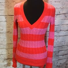AMERICAN EAGLE STRIPED CABLE KNIT V-NECK SWEATER Pink and coral orange sweater in like new condition..  SB-1 American Eagle Outfitters Sweaters V-Necks