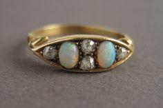 "Opal and Old Mine Cut Diamond 18k Gold Antique Victorian Ring - ""Boat Ring"" by springthaw on Etsy https://www.etsy.com/listing/234704413/opal-and-old-mine-cut-diamond-18k-gold"