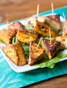 Simple Salt and Pepper Tofu Triangles (Served with Arugula Salad with Oranges and Caramelized Fennel: http://www.epicurious.com/recipes/food/views/Arugula-Salad-with-Oranges-and-Caramelized-Fennel-356909)