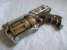 Easy to make out of toy guns and metallic paint. Bought a toy pistol for $1 that looks a lot like this.