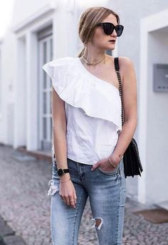 If your hot-weather vibe is a little more minimal, go big on summer whites and even bigger on ruffles. A structured asymmetric top, plus frayed skinnies is a no-brainer for summer-in-the-city feels – work with suede ankle boots, a leather cross-body and sharp cat-eye shades: