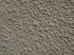 Creamy white textured wall of cottage