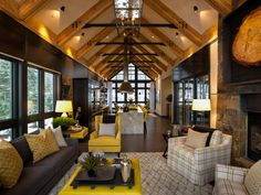 HGTV.com showcases the contemporary living room at HGTV Dream Home 2014, which features a warm neutral color palette, while a vaulted ceiling and exposed structural beams add an industrial design touch.