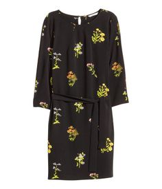 Short, straight-cut dress in textured-weave fabric with a printed pattern. Pleats at neckline and 3/4-length puff sleeves with elasticized cuffs. Narrow, removable tie belt at waist. Jersey lining.